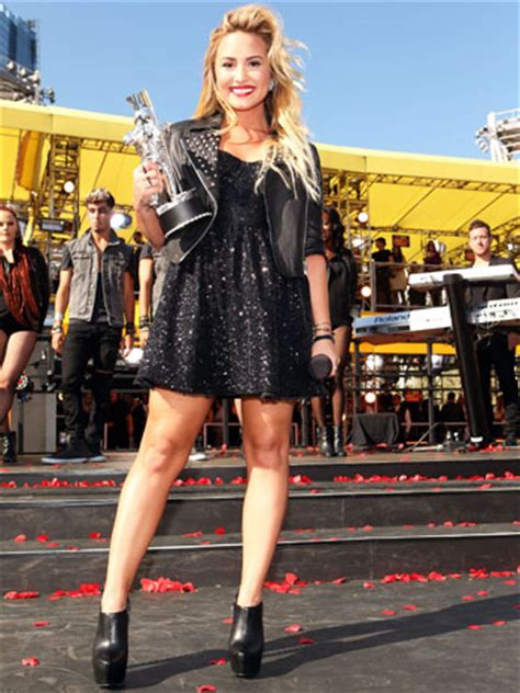 Demi Lovato on Working With Simon Cowell: 'He's a Bit of
